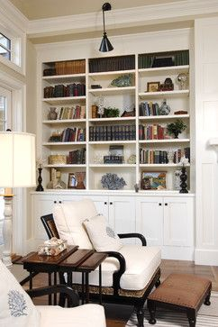 Pretty corner to cuddle with a book. Love the pillows.