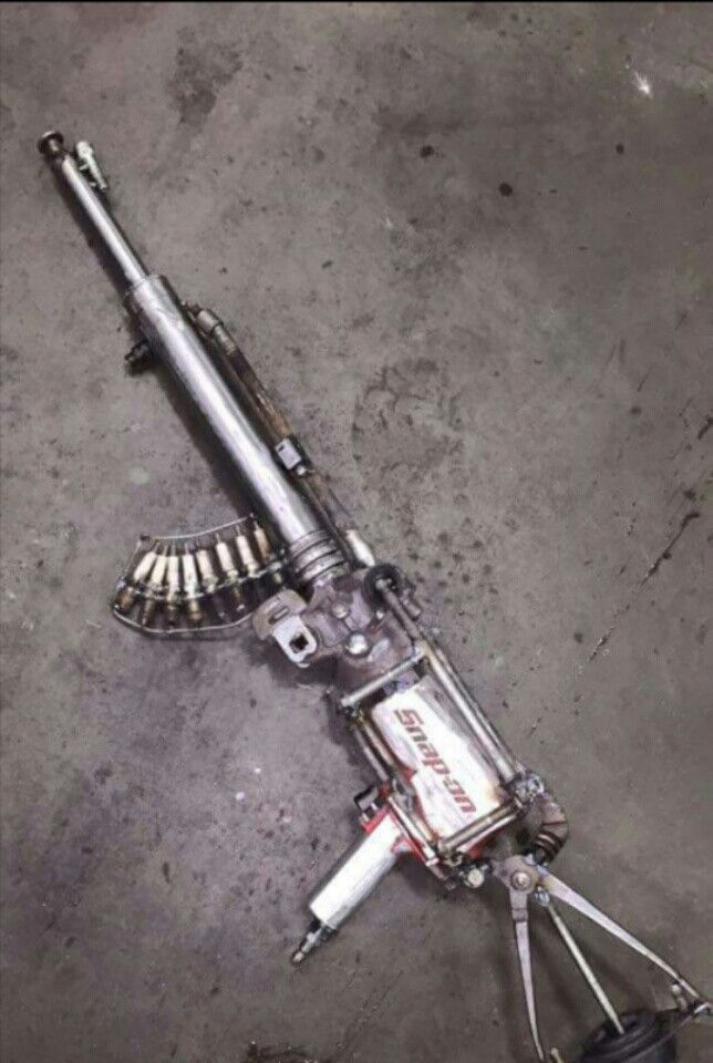 Funny, this is made out of car parts and automotive tools!! Looks like a Gun.