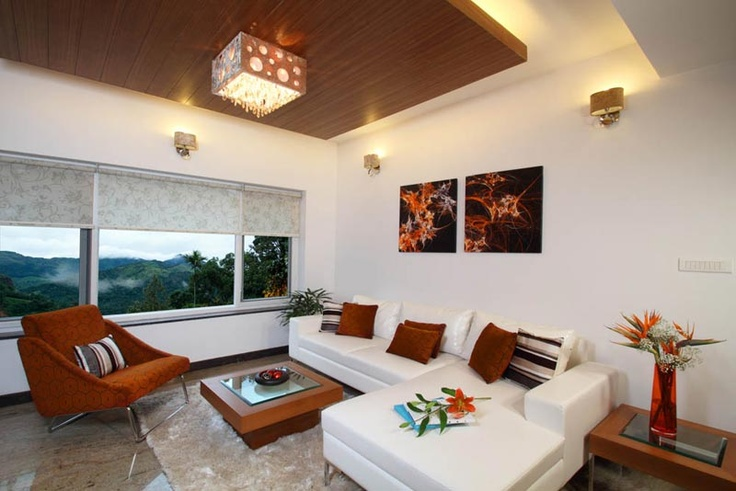 Living room with L shaped sofa   - Interior designers bangalore projects | professional interior design company Bangalore | Modern and Retail Interior Designers | Residential Interior Designers | commercial interior designers bangalore