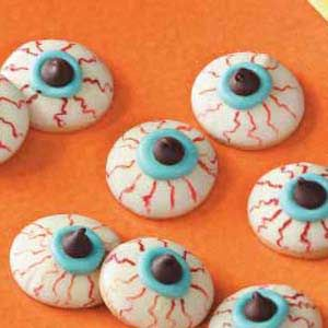 Eyeball Cookies... white chocolate dipped Nilla wafers, blue frosting, & chocolate chips... dip a toothpick in red food coloring to create bloodshot marks