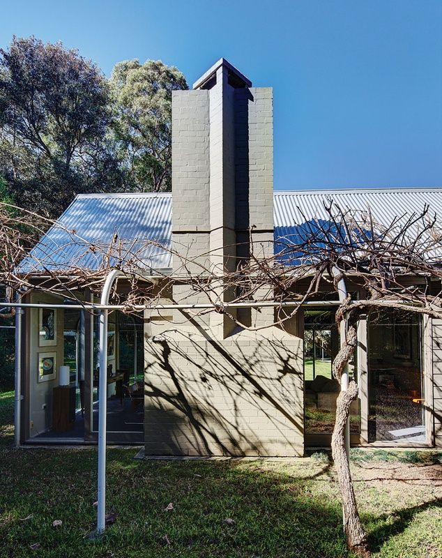 Hambrett House (1980s) revisited | ArchitectureAU.  The composition is neo-Georgian: glassed roof gables punctuated with masonry chimneys and trimmed with bullnose verandahs.