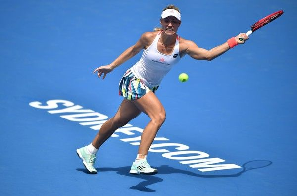 Angelique Kerber of Germany hits a return to Daria Kasatkina of Russia in their women's second round match at the Sydney International tennis tournament in Sydney on January 10, 2017. / AFP / Peter PARKS / IMAGE RESTRICTED TO EDITORIAL USE - STRICTLY NO COMMERCIAL USE