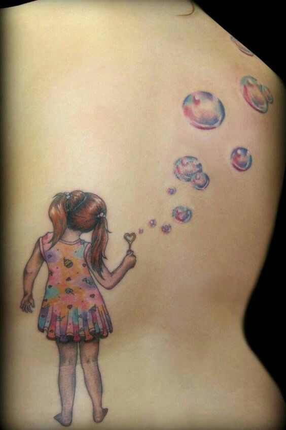 Back Tattoo Girl Blowing Bubbles