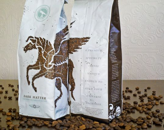 the pegasus on this coffee packaging was made from coffee grounds and pushed around with an x-acto knife into the design