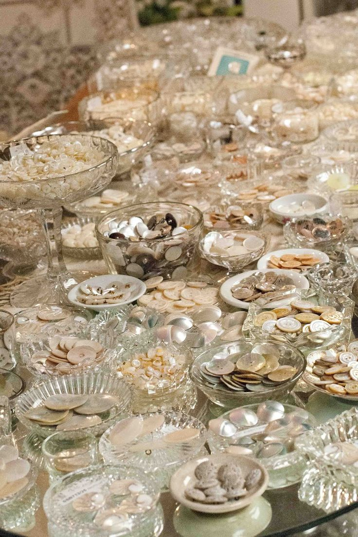 Loads of vintage Mother of Pearl Buttons each in their own little antique salt dish.  Wow!