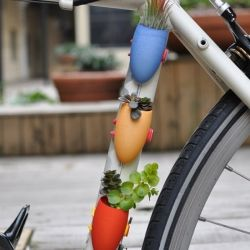Quirky planters for your bicycle. Must have.