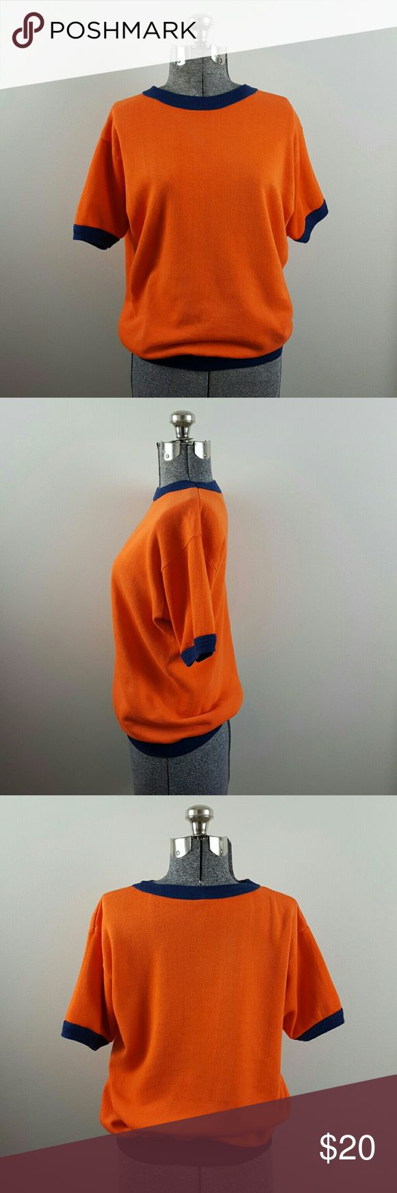Vintage 70's/80's Orange Ringer Sweatshirt Vintage JC Penney orange and blue short-sleeved ringer sweatshirt. Vintage size XL but fits like a women's M and a men's S. Very slight pilling and 3 pinpoint blue dots near the back right shoulder, otherwise in good vintage condition. Vintage Tops Sweatshirts & Hoodies