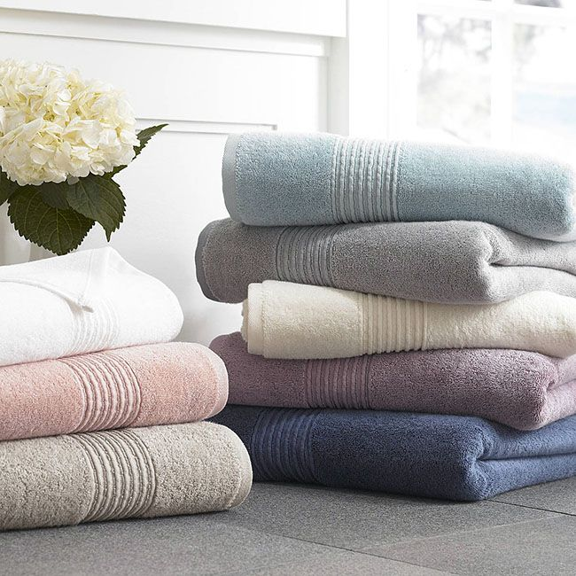 Exceptionally soft and smooth to the touch, our Modal bath towels are named for their luxuriant blend of 30% modal and 70% cotton. A staple collection for the bath, each towel has been exquisitely crafted in Turkey and features the classic comfort of a 600gsm weight with the style of an elegantly puckered border design.  DESIGN 70% cotton pile - 30% Modal Sewn in hanger loop 600 GSM Made to last