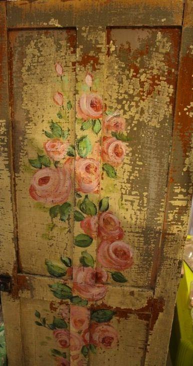 Painted flowers on door.