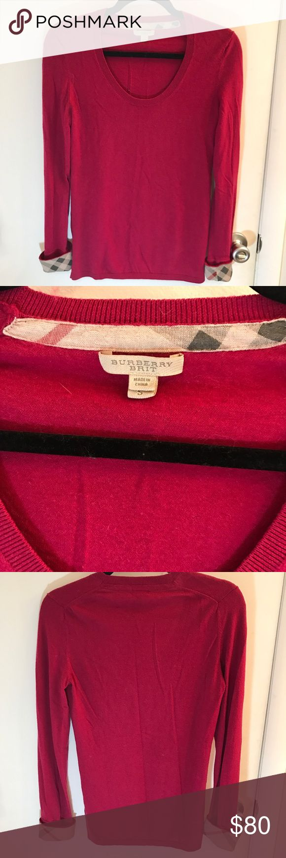 Raspberry Burberry Brit Sweater This classic Burberry sweater is accented with the trademark Burberry check print in the cuffs. The cuffs can be folded up or down, depending on whether you want the check to show. The wool is in excellent condition. Feel free to ask any questions or make a reasonable offer. Burberry Sweaters Crew & Scoop Necks