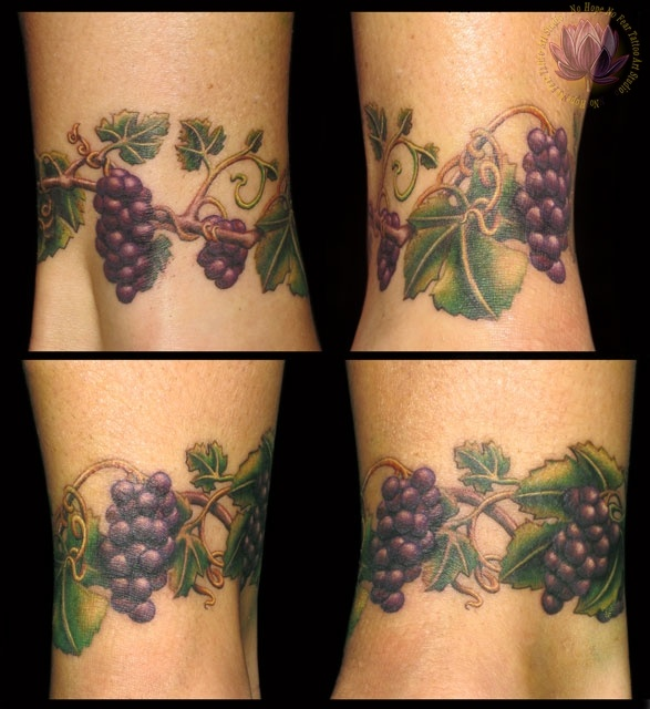 Something like this around my right ankle to cover up a fading paw print.
