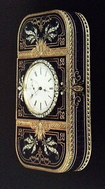 Antique Faberge engraved gold box with blue enamel and diamonds and a clock set into the lid.