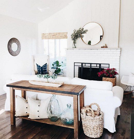 Love the mix of organic materials and textures in this all-white and wood living room.