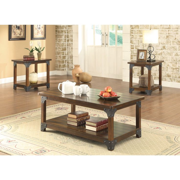 Wood combined with metal bracket design give this occasional set a craftsman style. Set features plank look grooved surfaces, tobacco brown finish, and storage shelf below.