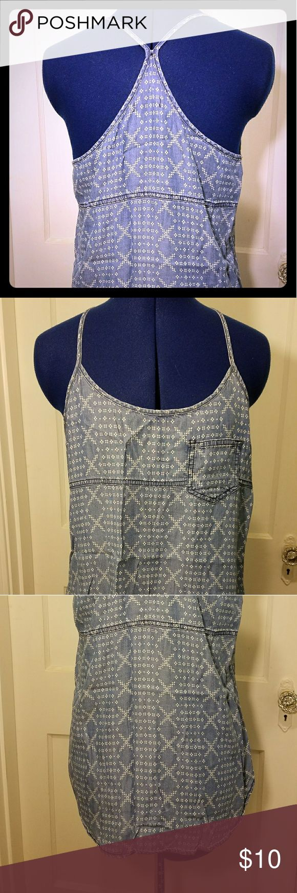 Maurices You've Got Me In Stitches Tank Ready for summer music festivals, this strappy tank has a very flowing form. A faux cross stitch patter gives the appearance of flowers. The synthetic fabric sort of looks and feels like jeans but it's light and flowy. 60% Lyocell, 40% viscose Maurices Tops Tank Tops