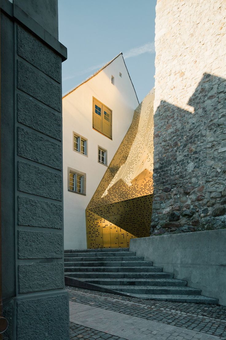 Rapperswil-Jona Municipal Museum extension by :mizd Architects. Exterior perforated bronze.