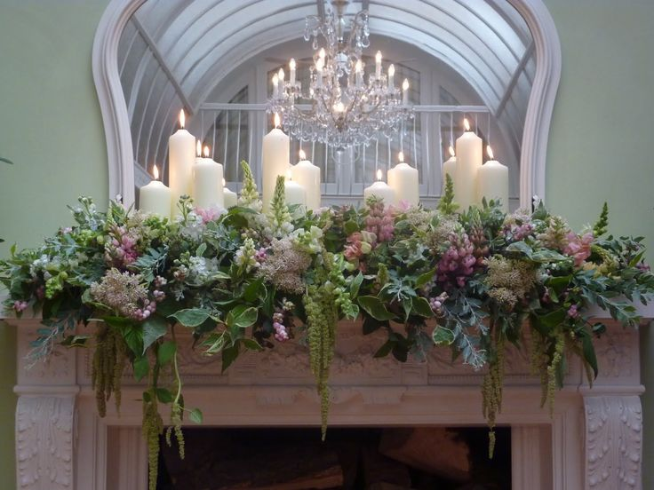Greens with hints of blue & lavender along with white candles = gorgeous mantelpiece arrangement for indoors.