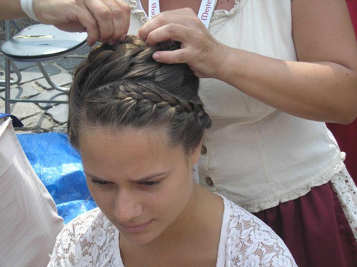 Corn row hairstyle.