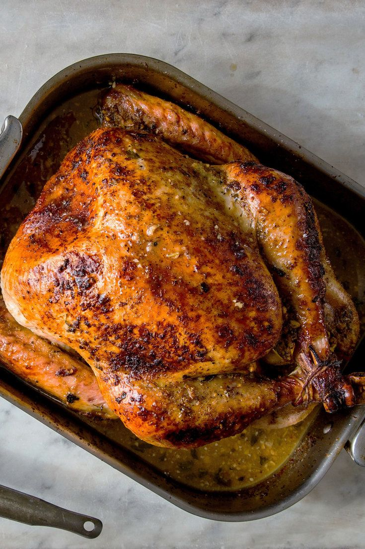 NYT Cooking: You need not conjure New England with your Thanksgiving turkey. This recipe nods to what happened when Cuban culture drifted onto the Thanksgiving tables of South Florida, with a bird dressed in a marinade of sour oranges (a mixture of orange and lime juice works as well) mixed with a lot of garlic and oregano. Serve the bird with black beans and white rice on the%...