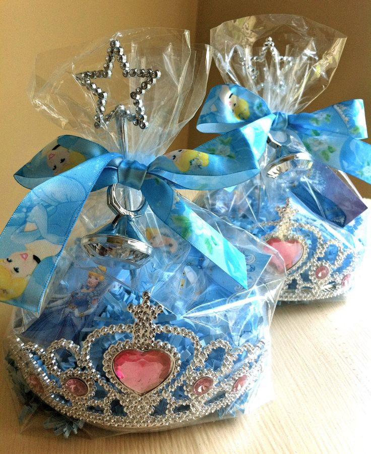 *Princess Favors. (This leads to a selling site but it's a great idea for favors you can make yourself.)  Take  a clear bag, put it inside a crown, fill it with candy, add a small wand to the middle, tie it with a ribbon with a ring in the center of the bow - So cute!