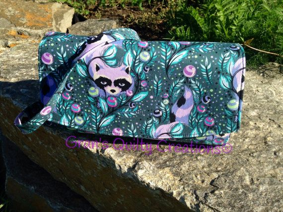 Glenda style convertible clutch purse with removable straps made with Tula Pink fabric line.