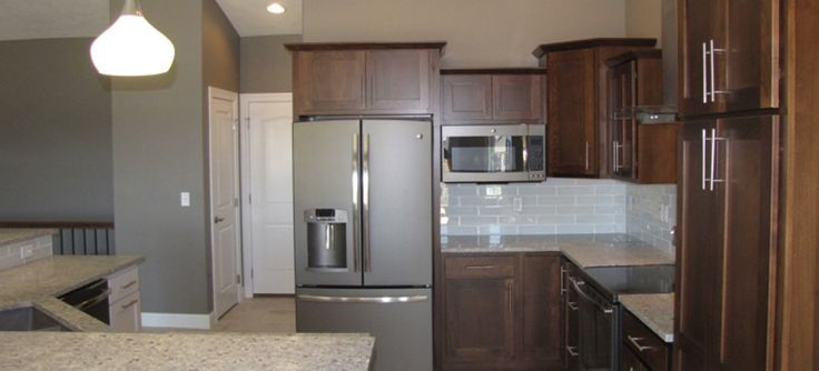Ge Slate Appliances In Stained Kitchen Cabinets