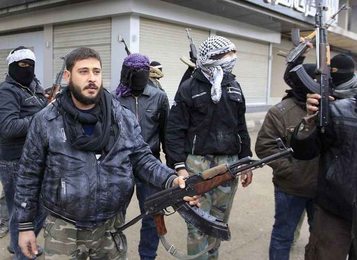 Syrian soldiers who have defected to join the free syrian army hold up their