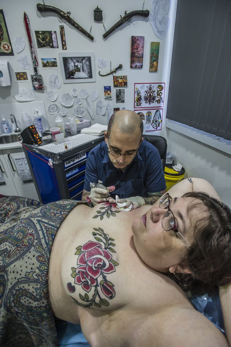 Ben Angelidis. Canberra, Australia. https://www.facebook.com/benangelidistattoo Check his work with survivor Sherry McGregor in this extensive piece for the Canberra Times. [p-ink.org]