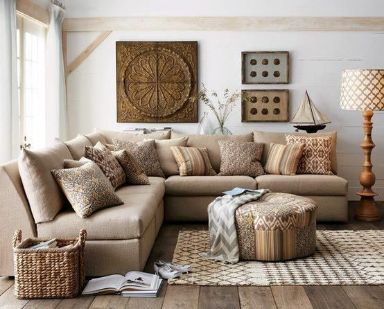 This sofa full of magnificent pillows could not be more inviting. The neutral color scheme is calming but texturally interesting.