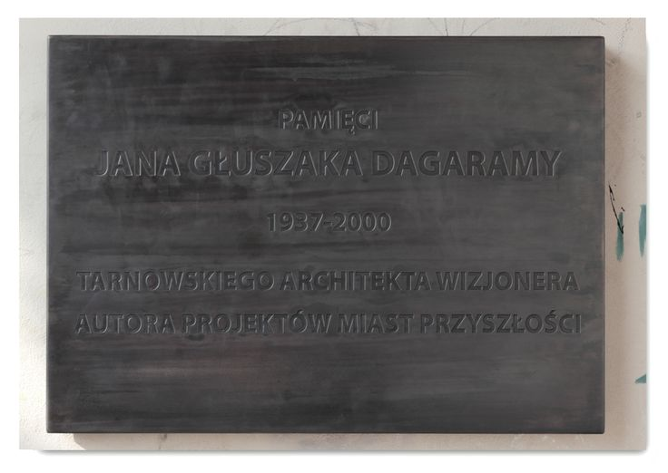 "Rafał Bujnowski, The plaque commemorating Jan Głuszak ""Dagarama"", brass, heating system, 2011, (photo Mateusz Sadowski, archives of BWA in Tarnów) ""PostcART: Ewa Łączyńska – Widz, Director at the BWA Gallery in Tarnów sent a postcard to Lynx"" http://contemporarylynx.co.uk/?p=844"