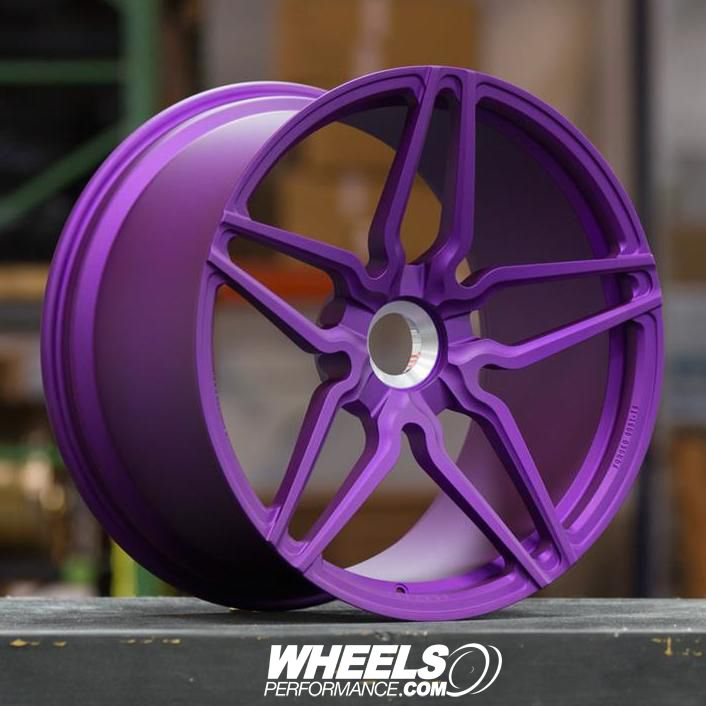 """Ultraviolet finish on this forged centerlock Vossen Forged HC-2 21"""" wheel. These are specifically designed and engineered for a 2017 Porsche 991 Turbo S. What color Porsche do you think would work best with these purple wheels? @wheelsperformance"""