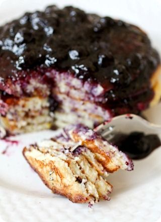 Delicious homemade lemon ricotta pancakes with blueberry sauce