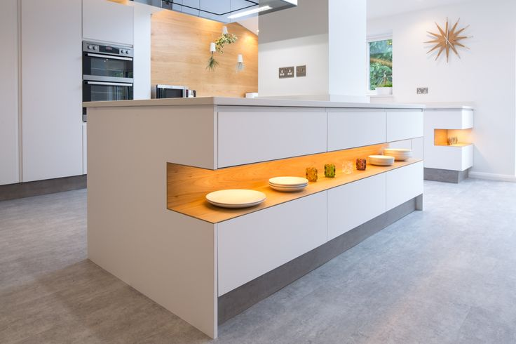 Stunning inset shelving in the kitchen. Using Bella Knebworth door in Porcelain White. A sleek and clean kitchen design by Vinny Smith of Northern Backdrop Interior Design and installed by Thornleys.
