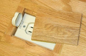 Floor outlet cover for use in wood floors