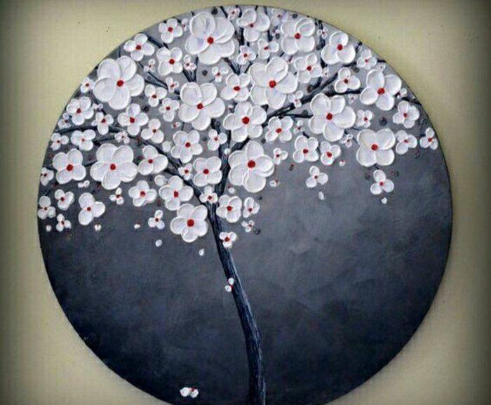 dessin sur galet, un cerisier couvert de fleurs, sur un fond gris, idée comment créer une décoration à offrir comme cadeau