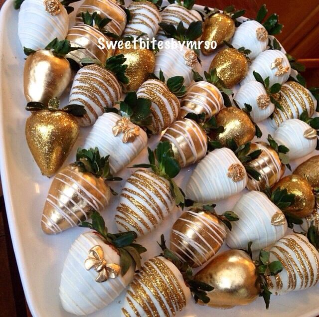 Gold glitter chocolate covered strawberries with bows