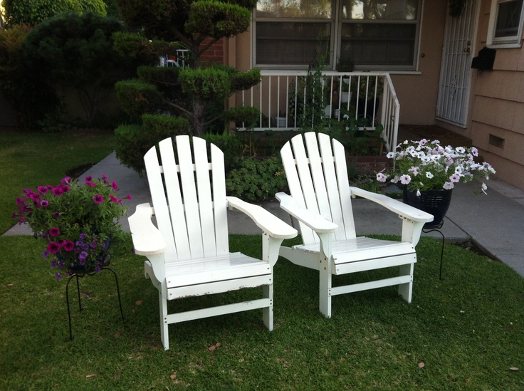 I added large flower pots next to the adirondack chairs in the front yard
