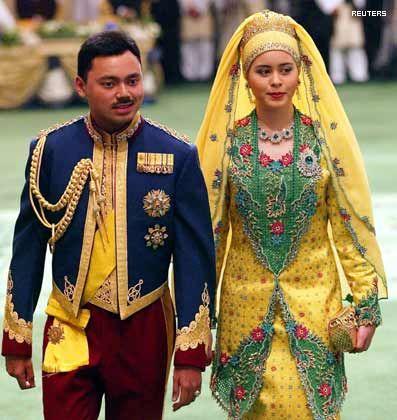 Brunei's Crown Prince Al-Muhtadee Billah Bolkiah and wife Sarah Pengiran Salleh arrive for the royal wedding banquet at Nurul Iman Palace in Bandar Seri Begawan.