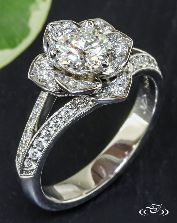 Diamond Rose Engagement RingA lush diamond rose blooms from a platinum split shoulder engagement ring. Dew-fine milgrain defines the piece's edges.#Ido #GreenLakeMade #EngagementRing