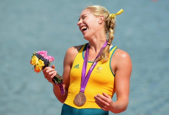 Kim Crow makes Olympic history - first Aussie womens rower to win two medals in two events - with a bronze medal in the single sculls          Kim Crow of Australia celebrates with her bronze medal during the medal ceremony for the Women's Single Sculls on Day 8 of the London 2012 Olympic Games at Eton Dorney on August 4, 2012.          © Harry How/Getty Images