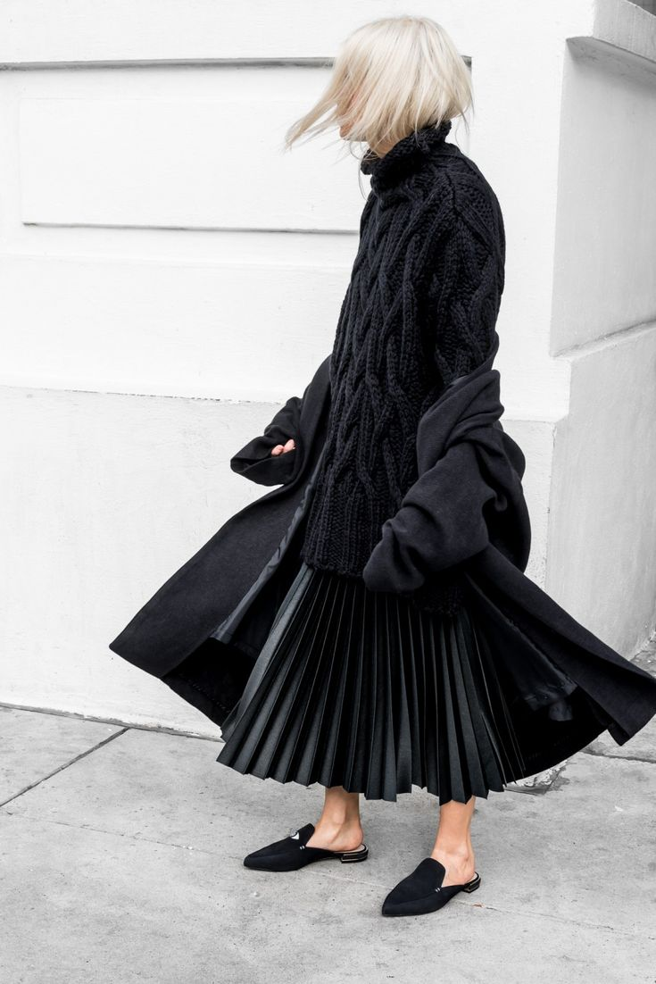 Black on black - cable sweater with pleated skirt