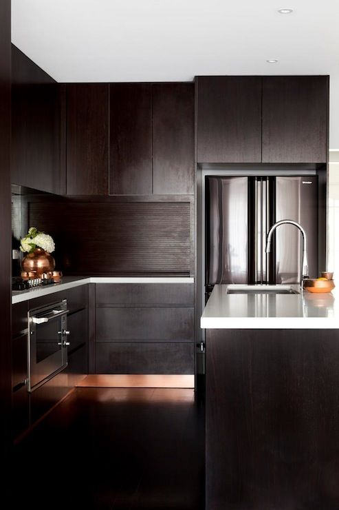 Camilla Molders Design: Sleek kitchen with frameless espresso cabinets paired with white quartz countertops and ...
