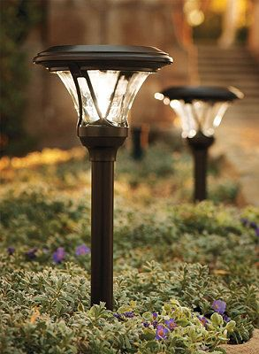 solar powered landscape path lighting is growing in popularity among homeowners also like the ground cover - Path Lights