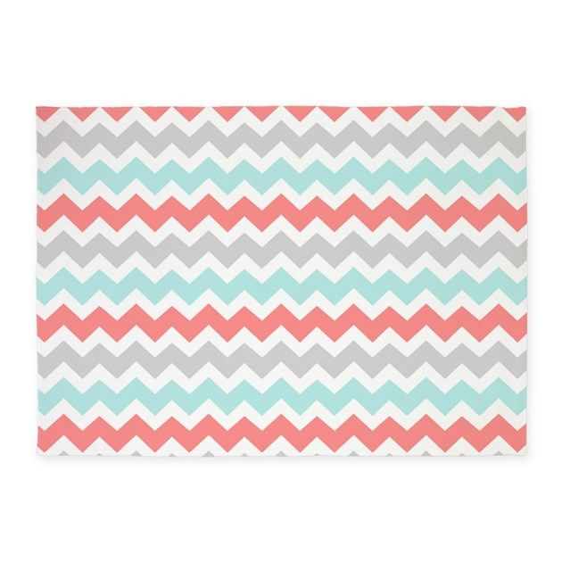 Modern and bold turquoise teal sky blue, gray, peach orange pink, and white retro chevron zigzags stripes pattern.