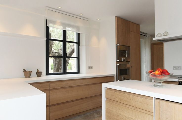 Réalisation d'une #cuisine en corian® et bois pour une villa à Ramatuelle / #Corian® and wooden #kitchen for a villa in #Ramatuelle #Home #Maison #Design #Deco #Bois #Wood #Wooden #SaintTropez #Carpentry #Menuiserie #Rafflin