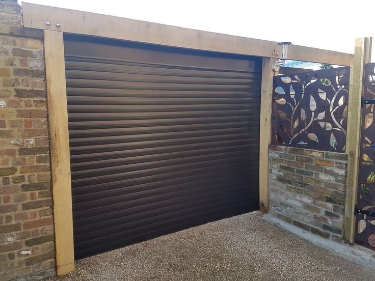 Single insulated electric roller garage door in brown