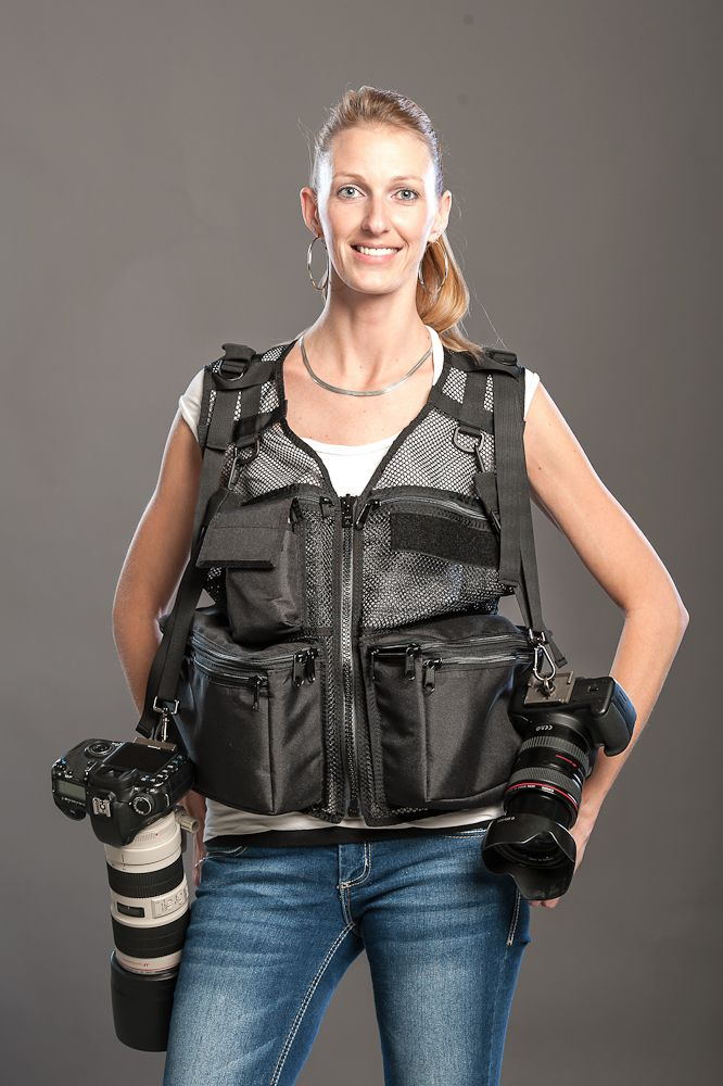 Photographers Vest thats not ugly. shorter,black, and more fitted. remember to distribute the weight of your gear evenly and bring waterproofing.