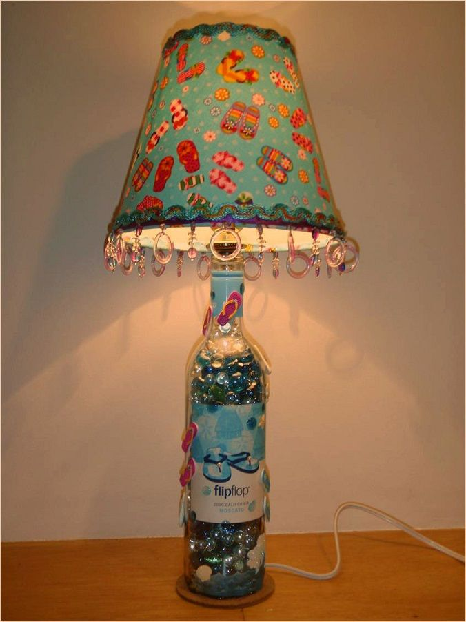 A recycled bottle a designed lamp shade and a lot of for Wine cork lampshade