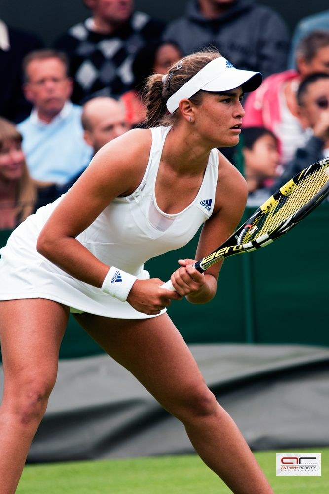 Pica Power in full effect - Monica Puig prepares to receive serve against Sara Errani at Wimbledon 2013 on court 18.