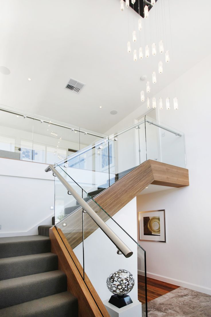 This stunning central staircase is a feature of the home and uses mixed materials and geometric angles to create an impression!